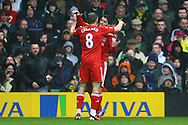 Picture by Paul Chesterton/Focus Images Ltd.  07904 640267.28/04/12.Luis Suárez of Liverpool scores his sides 1st goal and celebrates during the Barclays Premier League match at Carrow Road Stadium, Norwich.