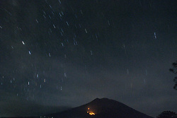 July 3, 2018 - Karang Asem, Bali, Indonesia - Bali, 03 July 2018 : Mount Agung Eruption with fluctuatif tention from big to small. For over almost a week since the end of June to begin of July Agung Mountain Erupted again with intensity from big one that put fire and also small intensity. Government still put the level of allert in level 3, Bali Air Port still operate because the ash from the eruption not effecting the air port. (Credit Image: © Donal Husni via ZUMA Wire)