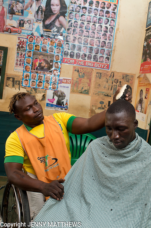 Uganda.  Adjumani. Julius Madra , hairdresser who runs the Link Up Saloon. He has a physical disability.