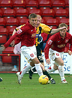 Photo: Dave Linney.<br />Walsall v Boston United. Coca Cola League 2. 27/01/2007.<br />Walsall's Craig Pead (R) heads goalwards, Boston's  Jason Kennedy meanwhile give chase.