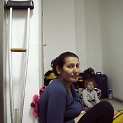 After a long journey from Syria and being refused to cross into Macedonia to continue their journey to Germany, this family has taken shelter outside a disused lift inside Hellenikon airport facility. The family with three children, visibly traumatised is among the hundreds waiting in limbo.