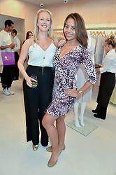 Left to right, GEORGINA COWAN and VISCOUNTESS WEYMOUTH at a party to celebrate the re-launch of the Ghost Flagship store at 120 King's Road, London on 15th April 2015.