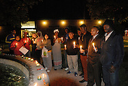 Canada, Ontario. Leamington, 2015. Memorial service and candle vigil on 04 October 2015 for Sheldon McKenzie, 40, a Jamaican migrant worker who died on 17 September 2015 after a long hospital stay. He leaves behind two teenage children. Friends, fellow workers and community activists hold candles at Italian Centential Park in uptown Leamington.