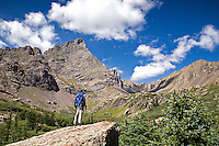 A man stops to take in the view of the Crestone Needle (14,203ft) from above Lower South Colony Lake in the Sangre de Cristo mountains near Westcliffe, Colorado. Model: Jessie Coffman