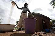 Mummuni Arishetu sorts sorghum as she prepares food for students at the Ying Anglican Primary School in the Savelugu-Nanton district, northern Ghana on Monday June 4, 2007. Through a partnership between parents and Catholic Relief Services (CRS) children who attend school are provided with a meal every day. According to one of the teachers, this alone is responsible for a 40 percent increase in attendance. CRS provides sorghum and oil, families provide tomatoes, fish and seasoning. Children also bring water and firewood from home.