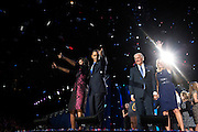 President Barack Obama, First Lady Michelle Obama, daughters Sasha and Malia, Vice President Joe Biden, Dr. Jill Biden and the Biden family wave to the crowd as confetti rains down, following the President's election night remarks at McCormick Place in Chicago, Illinois, Nov. 6, 2012. Also pictured are Beau, Hallie, Natalie, Baby Hunter, Hunter, Kathleen, Naomi, Finnegan, Maisy, Ashley Biden, and Howard Krein. (Official White House Photo by David Lienemann)<br /> <br /> Nov. 6, 2012 (Election Day)<br /> &quot;David Lienemann captured the Obamas and Bidens following the President&iacute;s election night remarks at McCormick Place in Chicago.&quot; (Official White House Photo by David Lienemann)++