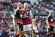Nottingham Forest midfielder Henri Lansbury (10)  marks Aston Villa   defender Ritchie De Laet (27) at a corner  during the EFL Sky Bet Championship match between Aston Villa and Nottingham Forest at Villa Park, Birmingham, England on 11 September 2016. Photo by Simon Davies.