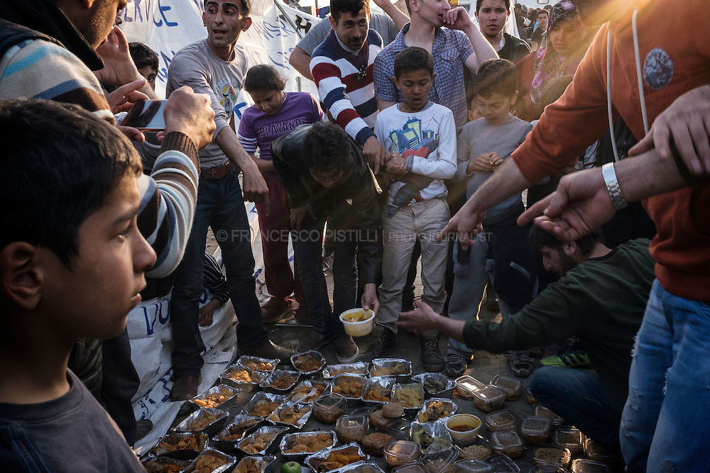 People protesting after mouldy food was given to a group of refugees in Idomeni camp. Part of a meal distributed by a Greek NGO was delivered rotten and was soon thrown out but people get very angry and exhausted.
