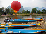 Hot air balloon rides for tourists by the Nam Song River, Vang Vieng, Laos.