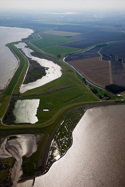Nederland, Groningen, Reider Buitenland, 08-09-2009; Punt van Reide met langs de kust Polder Breebaart, deze  polder staat onder invloed van het getij door middel van een duiker (gedempt getijdengebied). De natuurgebieden zijn in beheer bij het Groninger Landschap. Op het tweede plan Johannes Kerkhovenpolder.Point of Reide, the polder next to the coast has been 'depoldered', the water level is now influenced by the tides. .luchtfoto (toeslag); aerial photo (additional fee required); .foto Siebe Swart / photo Siebe Swart
