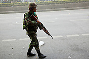 14 MAY 2010 - BANGKOK, THAILAND: A Thai soldier advances through smoke and haze on Rama IV Road in Bangkok Friday after clearing about 50 meters of the road of anti-government protesters who attacked the troops with rocks and home made explosives. Thai troops and anti government protesters clashed on Rama IV Road Friday afternoon in a series of running battles. Troops fired into the air and at protesters after protesters attacked the troops with rocket and small homemade explosives. Unlike similar confrontations in Bangkok, these protesters were not Red Shirts. Most of the protesters were residents of nearby Khlong Toei slum area, Bangkok's largest slum area. The running battle went on for at least two hours.   PHOTO BY JACK KURTZ
