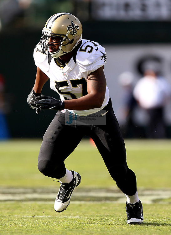 New Orleans Saints linebacker David Hawthorne (57) in action against the Oakland Raiders during an NFL game on Sunday, Nov. 18, 2012 at the Oakland Coliseum in Oakland, Ca.  (photo by Jed Jacobsohn)