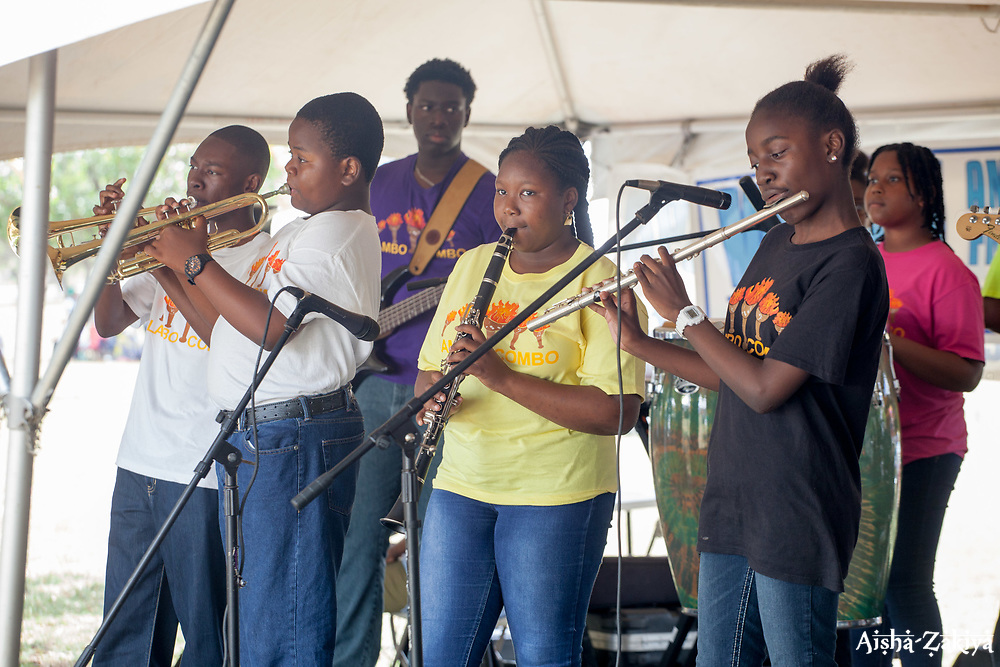 "Flambo Combo performs for the audience.  The University of the Virgin Islands hosts ""A Centennial Celebration of Delicacies for the Afternoon on the Green 2017 in celebration of the Virgin Islands Centennial and UVI's 55th anniversary.  Herman E. Moore Golf Course.  University of the Virgin Islands.  19 March 2017.  © Aisha-Zakiya Boyd"
