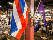 24 MARCH 2015 - MAHACHAI, SAMUT SAKHON, THAILAND:    A Thai flag hanging in the train station in Samut Sakhon (also called Mahachai) Thailand.  PHOTO BY JACK KURTZ