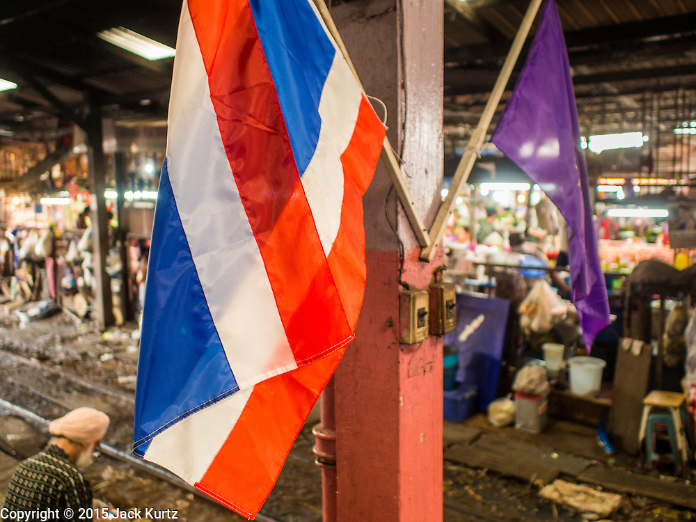 24 MARCH 2015 - MAHACHAI, SAMUT SAKHON, THAILAND:    A Thai flag hanging in the train station in Samut Sakhon (also called Mahachai) Thailand.  PHOTO BY JACK KURTZ