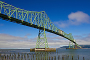 A green metal bridge across the Columbia River leading to Astoria in August of 2013 in Astoria, Oregon.