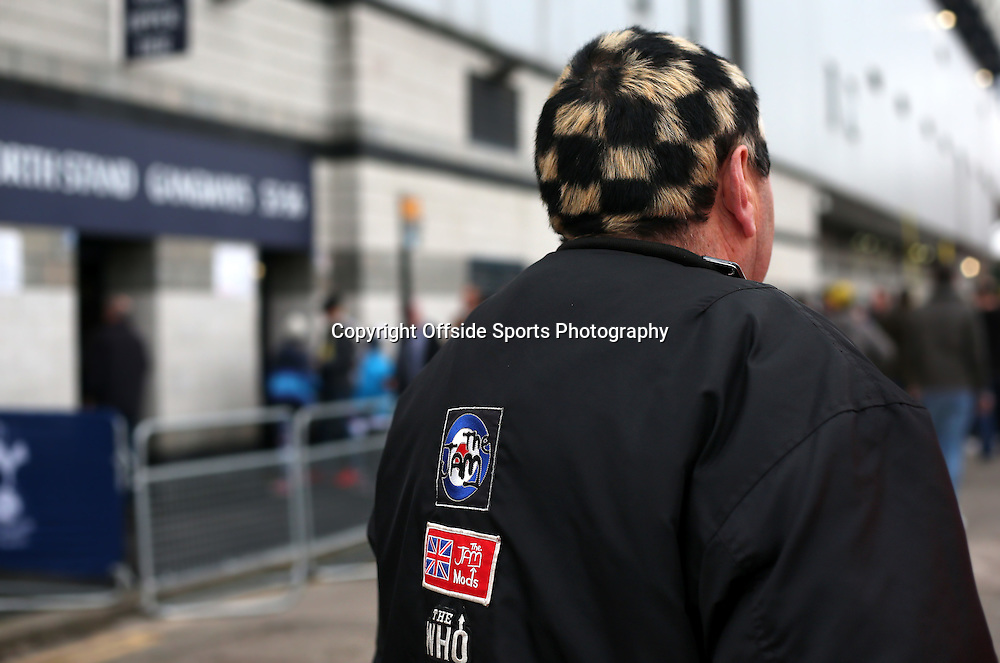 26 December 2015 - Premier League - Tottenham Hotspur v Norwich City<br /> A Norwich fan with hair dyed in a black and blonde checkered design <br /> Photo: Charlotte Wilson / Offside