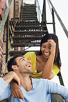 Couple Sitting on Fire Escape