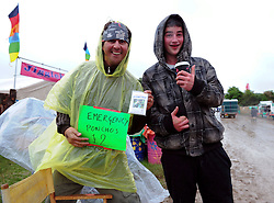 © licensed to London News Pictures. Glastonbury, UK  21/06/2011. Festival goers arriving at Glastonbury festival were greeted by heavy showers today (22/06/2011). Please see special instructions for usage rates. Photo credit should read Mary Stamm-Clarke/LNP
