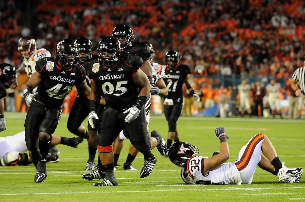 January 1, 2009: Darren Evans of the Virginia Tech Hokies is tackled by Terrill Byrd of the Cincinnati Bearcats during the NCAA football game between the Virginia Tech Hokies and the Cincinnati Bearcats in the Orange Bowl Classic. The Hokies defeated the Bearcats 20-7.