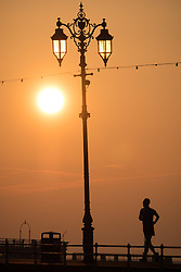 © Licensed to London News Pictures. 23/10/2016. Southsea, UK.  A man running along Southsea promenade. A fine start to the day at sunrise in Southsea this morning, where the Great South Run 2016 event is being held today.  Photo credit: Rob Arnold/LNP