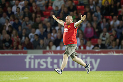 Image ©Licensed to i-Images Picture Agency. 07/08/2014. Salford, United Kingdom. Class of 92 Manchester. AJ Bell Stadium. Pitch invader . Class of 92 squad play Salford City FC at the AJ Bell Stadium . Picture by i-Images