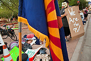17 OCTOBER 2011 - PHOENIX, AZ:   Protesters at the Occupy Phoenix protest Monday morning. About 40 people spent Sunday night on the sidewalks around the Cesar Chavez Plaza in Phoenix, AZ, the defacto headquarters of the Occupy Phoenix protest. Early Monday morning they got up to continue their chants and protests against Wall Street, the growing income gap between rich and poor in the US, and money in politics. Monday marks the third day of Occupy Phoenix.    PHOTO BY JACK KURTZ
