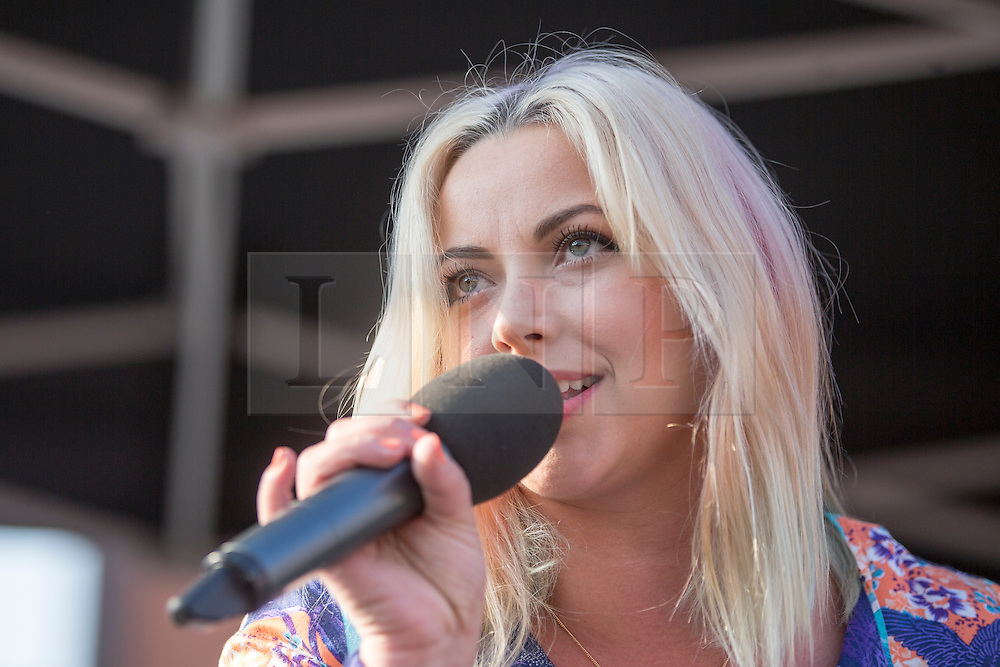 © Licensed to London News Pictures. 04/10/2015. Manchester, UK. Picture shows  Charlotte Church at the Anti Austerity protest in Manchester expected to attract thousands of people to protest against Austerity cuts at the start of the Conservative Party Conference in the city. Photo credit: Andrew McCaren/LNP