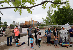 May 27, 2017 - Minneapolis, MN, USA - United States - A controversial new sculpture at the Walker Art Center that prompted an outcry among Minnesota's American Indian communities will be dismantled, the director said Saturday. Here, protestors outside a construction fence where inside is a  controversial new sculpture at the Walker Sculpture Garden Saturday, May 27, 2017, in Minneapolis, MN.]......DAVID JOLES • david.joles@startribune.com ......A controversial new sculpture at the Walker Art Center that prompted an outcry among Minnesota's American Indian communities will be dismantled, the director said Saturday. The work is partly based on the 1862 hanging of 38 Dakota tribal members in Mankato.**Janice Bad Moccasin,cq. (Credit Image: © David Joles/Minneapolis Star Tribune via ZUMA Wire)