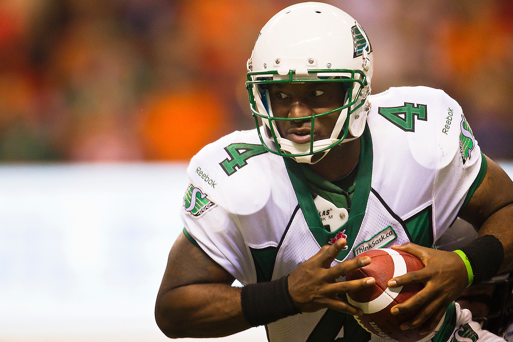 Saskatchewan Roughriders quarterback #4 Darian Durant protects the ball en route to a 31-17 victory versus the B.C. Lions Friday  October 4, 2013. SPORTSNET/Kevin Light