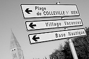 "Colleville sur Mer | Oct 15 2009..A roadsign pointing to ""Plage de Colleville sur mer"" (Plage d´Omaha, Omaha Beach) in the french village of Colleville sur Mer is seen in late afternoon light. Colleville sur Mer was one of the first villages to be freed by Allied Forces entering Europe on June 6, 1944 (D-Day).  ..Photo: juelich/ip-photo.com"