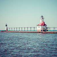 Saint Joseph Lighthouse retro picture. The St. Joseph Michigan Lighhouse and pier catwalk are a popular local attraction. The photo is high resolution and was taken in 2013. Image Copyright © Paul Velgos All Rights Reserved.
