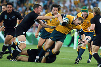 Photo. Steve Holland.Australia v New Zealand, Semi-final at the Telstra Stadium, Sydney. RWC 2003.<br />15/11/2003.<br />Australia's Stirling Mortlock is tackled by Nz's Reuben Thorne, left.