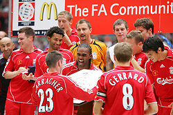CARDIFF, WALES - SUNDAY, AUGUST 13th, 2006: Liverpool's Jamie Carragher pass on the trophy to his team-mates after wining 2-1 the Community Shield match against Chelsea at the Millennium Stadium. (Pic by David Rawcliffe/Propaganda)