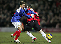 Photo: Lee Earle.<br /> Portsmouth v Manchester United. The Barclays Premiership. 11/02/2006. Portsmouth's Andres D'Alessandro (L) gets the better of Wayne Rooney.