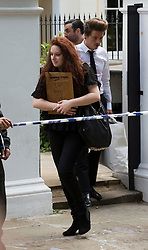 © licensed to London News Pictures.  28/07/2011. London, UK. Family and friend of  Amy Winehouse leave Amy's home in Camden, North London toady (28/07/2011) carrying personal items belonging to the  singer. Photo credit: Ben Cawthra/LNP