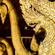 Gold nagas (King Cobras) at Wat Mai Suwannaphumaham.  Wat Mai, as it is often known, is a Buddhist temple in Luang Prabang, Laos, located near the Royal Palace Museum. It was built in the 18th century and is one of the most richly decorated Wats in Luang Prabang.