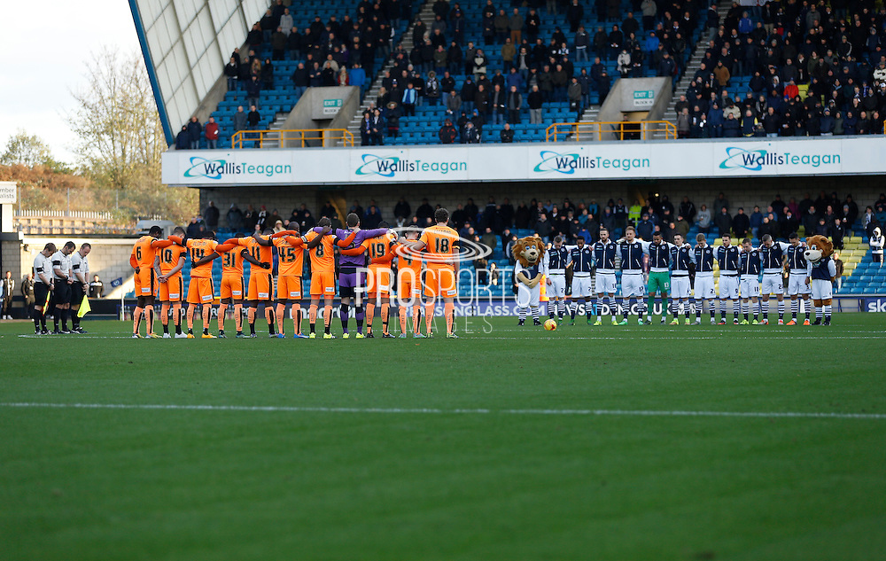 A minute silence before the Sky Bet League 1 match between Millwall and Colchester United at The Den, London, England on 21 November 2015. Photo by Andy Walter.