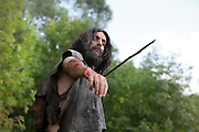 Scene of a hunter about to throw a spear in prehistoric times. Image taken from the filming of 'Paris la ville a remonter le temps' written by Carlo de Boutiny and Alain Zenou, directed by Xavier Lefebvre, a Gedeon Programmes production. Picture by Manuel Cohen