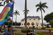 A marcher with a modifeid Taiwan flag moves past the gate to Chiang Kai Shek Memorial Hall. Taiwan is generally very accepting of homosexuality, and campaigns are underway to make it the first country in Asia to legalize gay marriage.