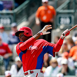 Mar 3, 2013; Sarasota, FL, USA; Philadelphia Phillies left fielder John Mayberry Jr. (15) doubles against the Baltimore Orioles during the top of the second inning of a spring training game at Ed Smith Stadium. Mandatory Credit: Derick E. Hingle-USA TODAY Sports