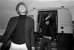 The Rolling Stones Charlie is my Darling - Ireland 1965..Brian Jones and Keith Richards of The Rolling Stones exiting the airport bus at Dublin Airport before thier concert at the Adelphi Theatre. This was the band's second Irish tour of 1965...The Rolling Stones Charlie is my Darling - Ireland 1965.Out November 2nd from ABKCO.Super Deluxe Box Set/Blu-ray and DVD Details Revealed. .03/09/1965.09/03/1965.03 September 1965..ABKCO Films is proud to join in the celebration of the Rolling Stones 50th Anniversary by announcing exclusive details of the release of the legendary, but never before officially released film, The Rolling Stones Charlie is my Darling - Ireland 1965.  The film marked the cinematic debut of the band, and will be released in Super Deluxe Box Set, Blu-ray and DVD configurations on November 2nd (5th in UK & 6th in North America).. .The Rolling Stones Charlie is my Darling - Ireland 1965 was shot on a quick weekend tour of Ireland just weeks after ?(I Can't Get No) Satisfaction? hit # 1 on the charts and became the international anthem for an entire generation.  Charlie is my Darling is an intimate, behind-the-scenes diary of life on the road with the young Rolling Stones featuring the first professionally filmed concert performances of the band's long and storied touring career, documenting the early frenzy of their fans and the riots their live performances incited.. .Charlie is my Darling showcases dramatic concert footage - including electrifying performances of ?The Last Time,? ?Time Is On My Side? and the first ever concert performance of the Stones counterculture classic, ?(I Can't Get No) Satisfaction.?  Candid, off-the-cuff interviews are juxtaposed with revealing, comical scenes of the band goofing around with each other. It's also an insider's glimpse into the band's developing musical style by blending blues, R&B and rock-n-roll riffs, and the film captures the spark about to combust into The Greatest Rock and Roll Band in the World.. .The