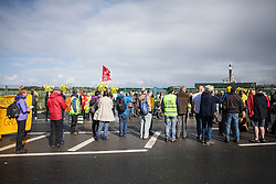 © Licensed to London News Pictures. 29/09/2017. Lancashire, UK.  Protester outside Cuadrillas Hydraulic Fracturing site on Preston New Road, Lancashire. Over 100 protesters from all over the UK turned joined the on going anti-fracking protest on Preston New Road in Lancashire ahead of the Conservative Party Conference in Manchester. Photo credit: Steven Speed/LNP