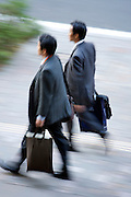 overhead view of two businessmen walking