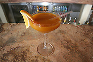 Mango Margarita in a martini glass, with a straw, lemon on a side and a chilly rim<br /> <br /> Capella Spicy Mango Margarita Signature Cocktail recipe:<br /> <br /> Ingredients:<br /> 1.5 Oz. White Tequlla<br /> 0.5 Oz. Orange Liquor (Triple Sec)<br /> 1 Oz. Fresh Lime Juice<br /> 0.5 Oz. Mango Concentrate<br /> Half tea spoon of Tajin Chipotle<br /> <br /> Method:<br /> Mix all the ingredients in a blender with ice and serve in a martini glass.<br /> Shake all the ingredients to serve in on the rocks, chilli rimmed<br /> <br /> Salud!