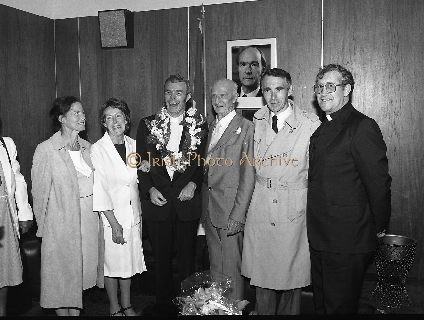 """Fr Niall O'Brien Returns from Captivity.1984..14.07.1984..07.14.1984..On 6 May 1983,Fr Niall O'Brien was arrested along with two other priests, Fr. Brian Gore, an Australian, Fr. Vicente Dangan, a Filipino and six lay workers - the so-called """"Negros Nine"""", for the murders of Mayor Pablo Sola of Kabankalan and four companions. The priests where held under house arrest for eight months but """"escaped"""" to prison in Bacolod City, the provincial capital, where they felt they would be safer.The case received widespread publicity in Ireland and Australia, the home of one of the co-accused priests, Fr. Brian Gore. When Ronald Reagan visited Ireland in 1984, he was asked on Irish TV how he could help the missionary priest's situation. A phone call the next day from the Reagan administration to Ferdinand Marcos resulted in Marcos offering a pardon to Fr. O'Brien and his co-accused..(Ref Wikipedia)...Fr Niall is pictured with his family  in the V I P lounge at Dublin Airport under the photograph of President Hillery."""