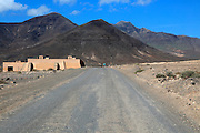 Unsurfaced road and mountains, Jandia peninsula, Fuerteventura, Canary Islands, Spain