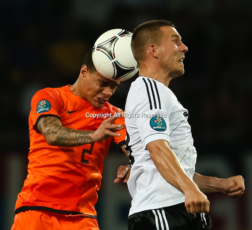 13.06.2012 Ukraine, Kharkiv : Ukraine, Kharkiv.  Netherlands national team player John Heitinga (left) and German national team player Bastian Schweinsteiger in the group stage European Football Championship match between teams of the Netherlands and Germany.