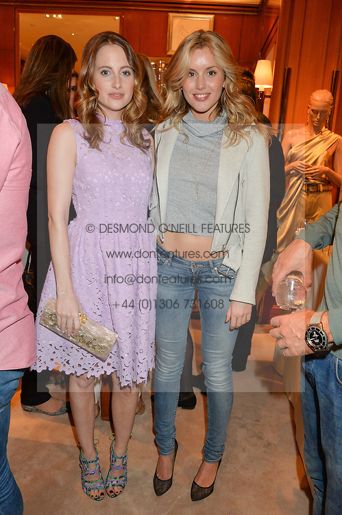 Left to right, CAGGIE DUNLOP and ROSIE FORTESCUE at a party to celebrate the publication of Front Roe by Louise Roe held at Ralph Lauren, 1 New Bond Street, London on 1st April 2015.