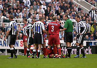 Photo. Glyn Thomas<br />Newcastle United v Bolton Wanderers. <br />Barclaycard Premiership.<br />St James' Park, Newcastle. 20/09/2003.<br />Newcastle players are not happy after Ivan Campo appeared to dive after a tackle. Bolton's Simon Charlton however supports his team mate.